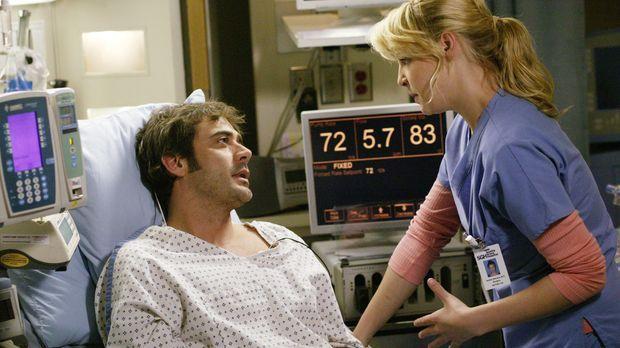 Izzie (Katherine Heigl, r.) überbringt Denny (Jeffrey Dean Morgan, l.) die Na...