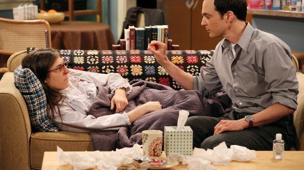 Während Sheldon (Jim Parsons, r.) um Amy (Mayim Bialik, l.) kümmert als sie k...