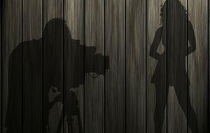 Erotik-Video-Dreh - Schatten von Kamera und Darstellerin