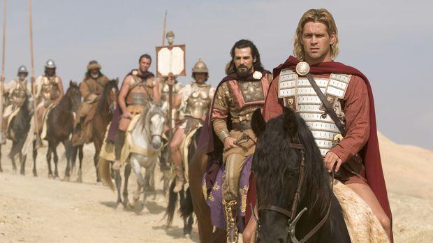 Beginnt einen neuen Eroberungsfeldzug, obwohl seine Männer nach Hause wollen:...